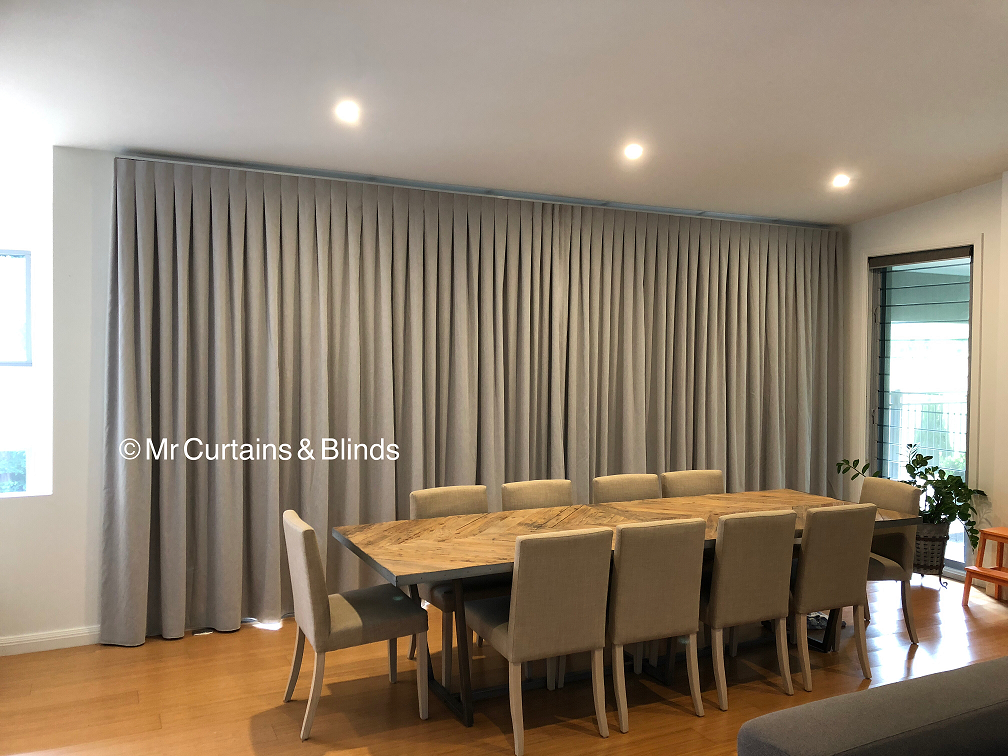 Beautiful pleated curtains on a sleek platinum track Erina Heights