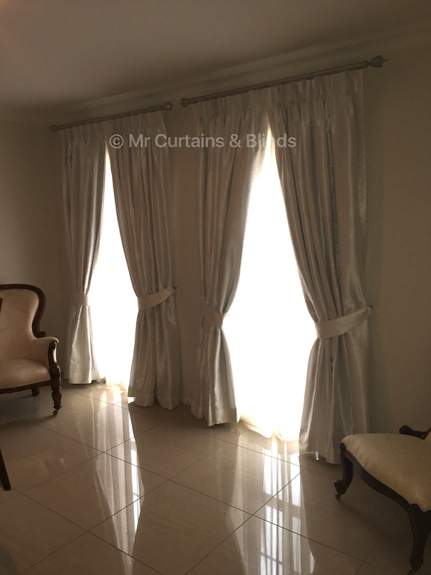 Blockout lined pinch pleat curtains with sheer curtains behind Terrigal home Fabrics Truman and Kasos by Warwick