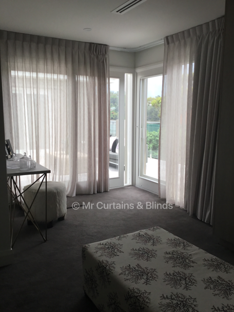 Inverted pleat curtains on curved tracking Terrigal home Fabric Capri by Charles Parsons