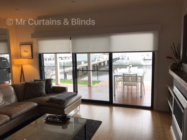Motorised translucent roller blinds with painted timber Pelmets